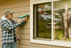 extend the life of windows by filling in any cracks with caulk | TruHome Inc services Monroe, WI and Tristate area